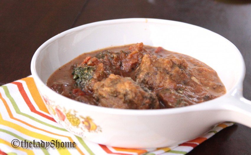 spinach balls in a gravy plate